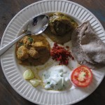My plate of lunch: chicken curry, eggplant, raita, rotli